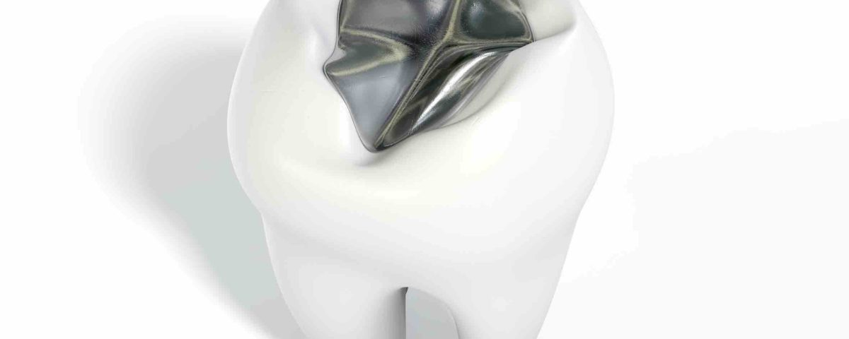 A lead cavity filling on a single molar on an isolated background